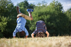 Two boys making a somersault. And having fun at the park Stock Photography