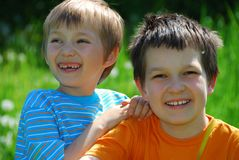Two boys in meadow Stock Photos