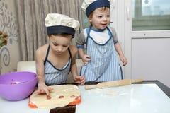 Two Boys mold dumplings Stock Images