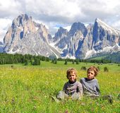 Two boys in mountains Stock Photos