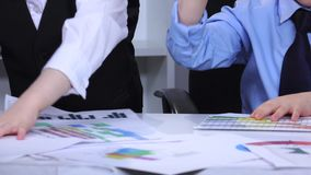 Two boys in the office on the table scatter diagram. Slow motion. Close up stock footage