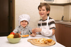 Two boys with orange Stock Images