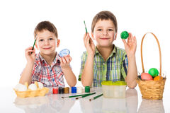 Two boys painting easter eggs Royalty Free Stock Photo
