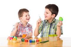 Two boys painting easter eggs Royalty Free Stock Image