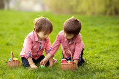 Two boys in the park, having fun with eggs for Easter Stock Photography