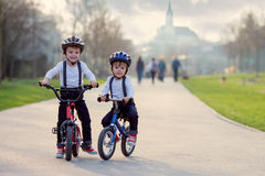 Two boys in the park, riding bikes Royalty Free Stock Photo