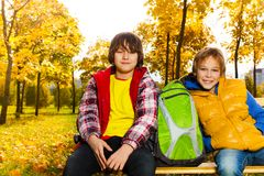 Two boys in park after school Stock Photography