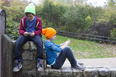 Two boys with phones Royalty Free Stock Images