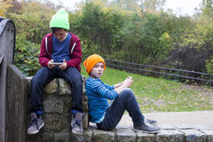 Two boys with phones Royalty Free Stock Photography