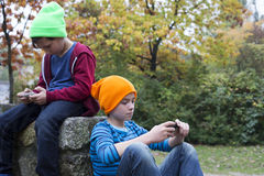Two boys with phones stock image