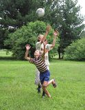 Two boys play with boll. On the green grass Royalty Free Stock Photos