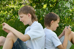 Two boys play a game Stock Photography
