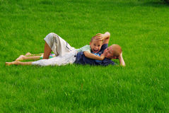 Two boys play on the grass Stock Photography