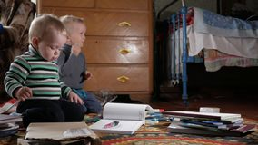 Two boys play at home with stationery. Cute brothers spend interesting time stock video footage
