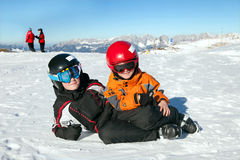 Two boys play on mountain summit Royalty Free Stock Image
