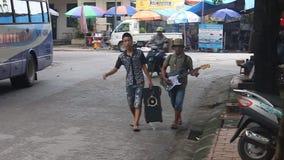Two boys play music on a street. HAI PHONG, VIETNAM - AUGUST 7: Two boys play music on a street on August 7, 2012 in Hai Phong, Vietnam stock video footage