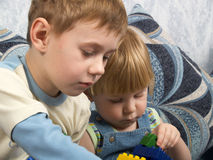 Two boys play toys Royalty Free Stock Image