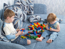 Two Boys Play Toys Stock Images