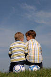 Two boys playing. Brothers having fun on top of a hill Stock Photos