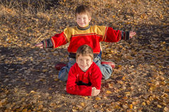 Two boys playing on autumn park Stock Photo