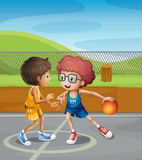 Two boys playing basketball at the court. Illustration of two boys playing basketball at the court Stock Photo