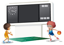 Two boys playing basketball in a court with a scoreboard Stock Photos