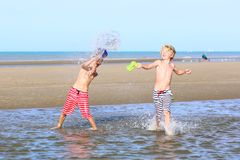 Two boys playing on the beach Stock Image