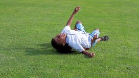 Two boys are playing. Two brothers are fighting and having fun on the sunny glade stock footage