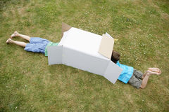 Two Boys Playing In Cardboard Box Royalty Free Stock Photo