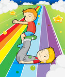 Two boys playing at the colorful road Royalty Free Stock Photo