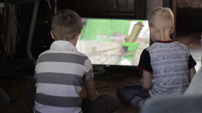 Two  boys playing computer games sitting at home. Two boys playing computer games sitting at home stock footage