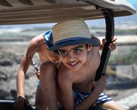 Boys playing on a golf buggy at a beach resort. stock image