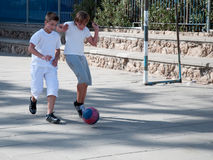 Two boys  playing football. Stock Image