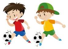 Two boys playing football Stock Image