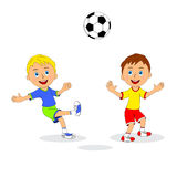 Two boys playing football Stock Photos
