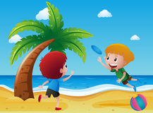 Two boys playing frisbee on the beach Stock Photo