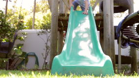 Two Boys Playing On Garden Slide Together stock video