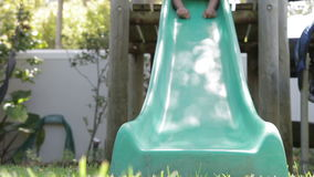 Two Boys Playing On Garden Slide Together stock video footage
