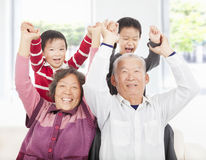 Two boys playing with grandparents Stock Photography