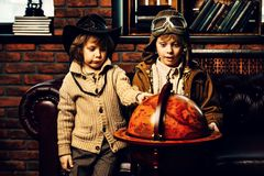 Around the world. Two boys are playing at home to travelers. Childhood. Fantasy, imagination royalty free stock images