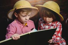 Brothers with map. Two boys are playing at home to travelers. Childhood. Fantasy, imagination royalty free stock photos