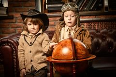 Games for boys. Two boys are playing at home to travelers. Childhood. Fantasy, imagination royalty free stock image