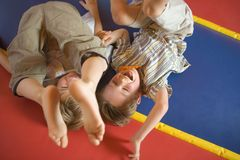 Two boys playing on an inflatable bouncy castle Royalty Free Stock Images
