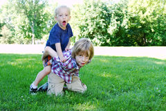 Two boys playing in park Stock Photo