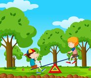 Two boys playing seesaw in the park Royalty Free Stock Images