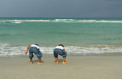 Two Boys Playing by the Shore Stock Images