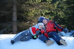 Two boys playing in snow. A view of two boys playing together in the snow Royalty Free Stock Images