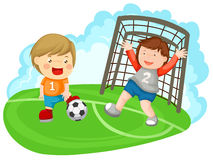 Two boys playing soccer Royalty Free Stock Image