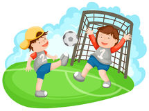 Two boys playing soccer Stock Photos