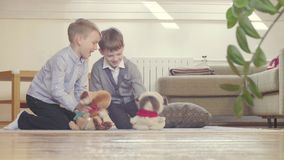 Two boys playing stuffed toys stock footage